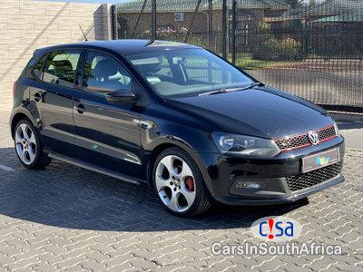 Pictures of Volkswagen Polo 1.4 Automatic 2011